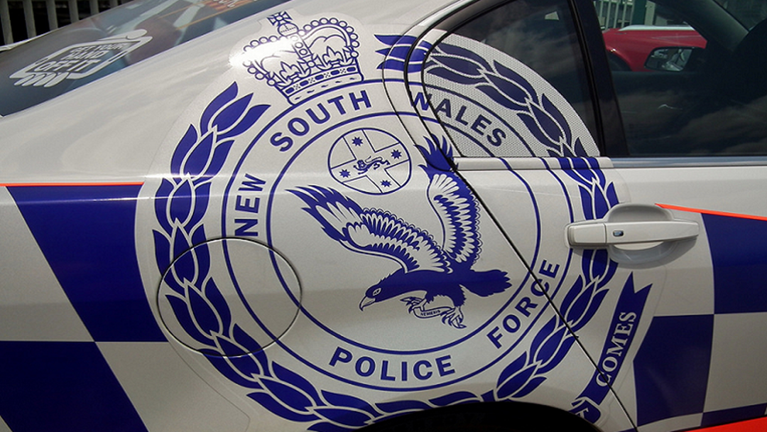 Woman charged over fatal crash