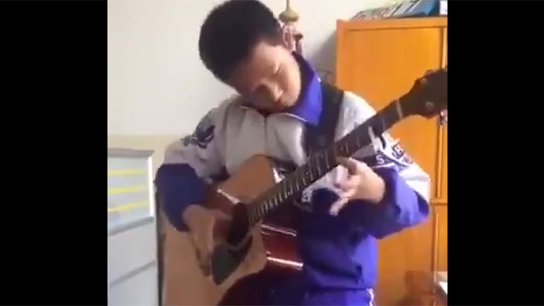 13 Year Old Plays Thunderstruck On An Acoustic And It Sounds Awesome