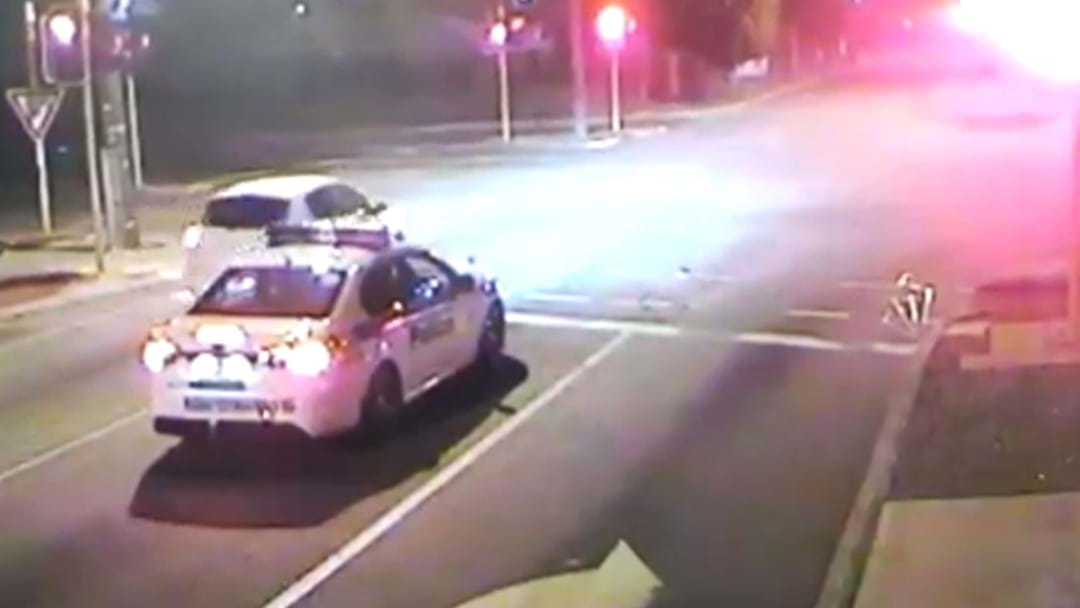 Next Level Brain Fade As Perth Driver Runs A Red Light Next To A Cop Car