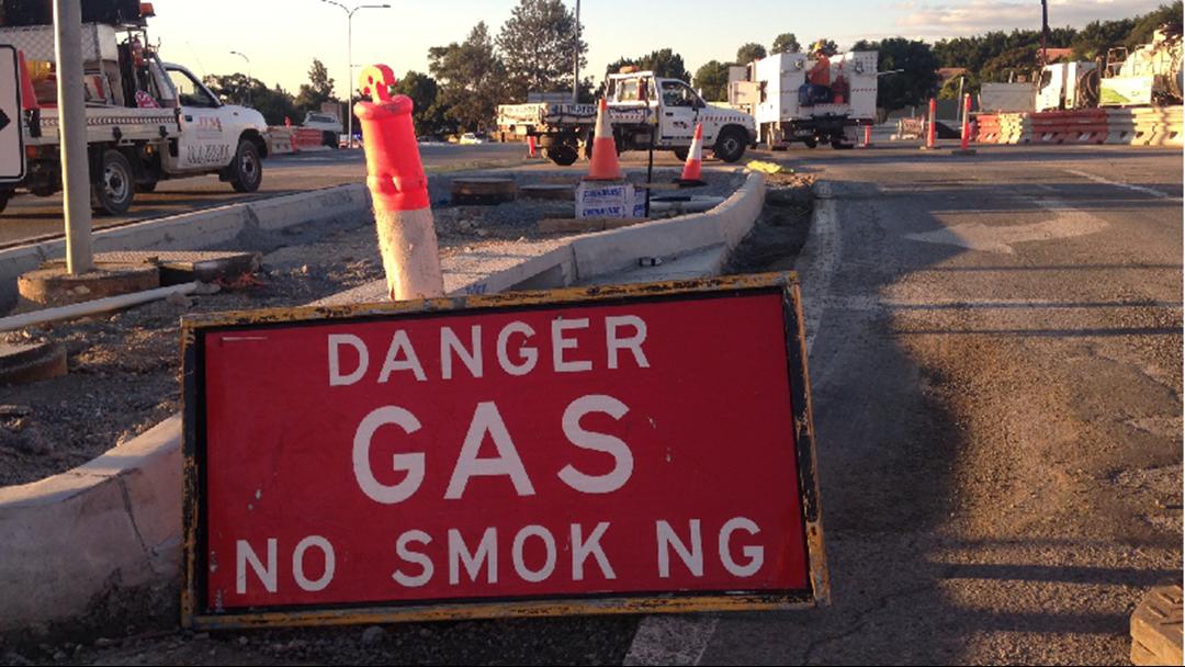 Road closures as worker cuts through gas main