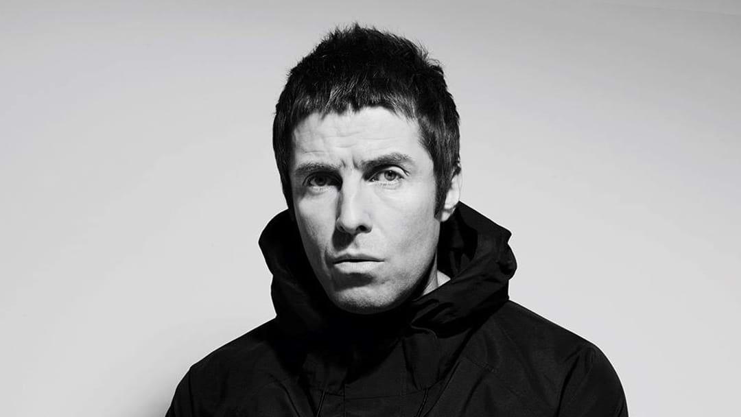 Bloke Marks Homework During Liam Gallagher Festival Appearance