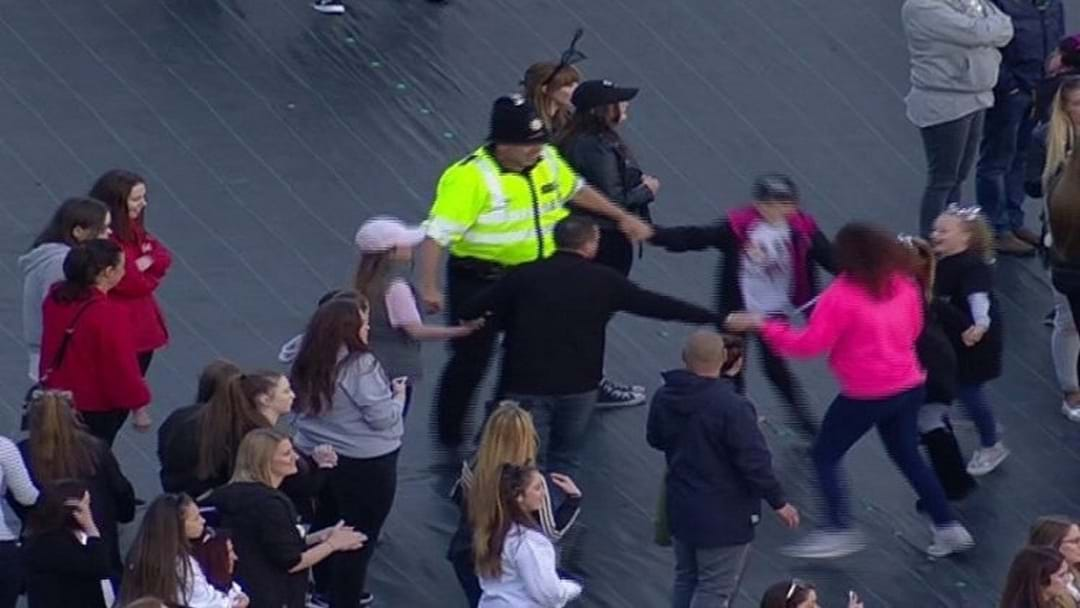 Legend Police Officer Dances With Kids At Manchester One Love Concert
