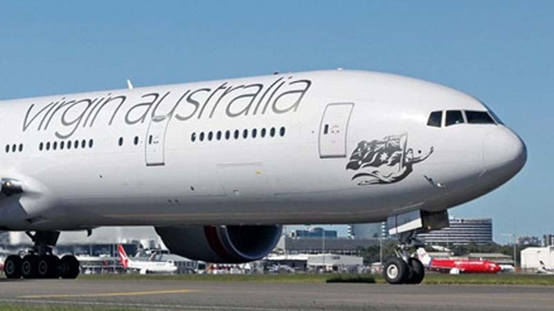 Man arrested over note found in Australian airliner toilet