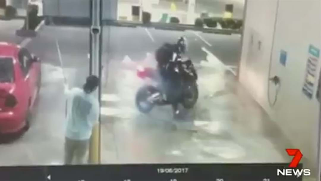 Dopey Queenslander Somehow Manages To Smash His Bike In A Car Wash