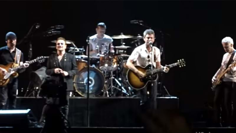 Article heading image for WATCH: U2 & Noel Gallagher Perform Oasis Classic