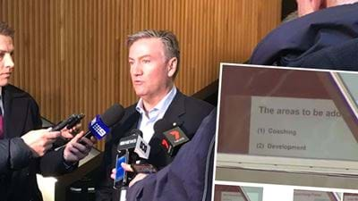 Parts Of Collingwood's Board Presentation Filmed Through Window
