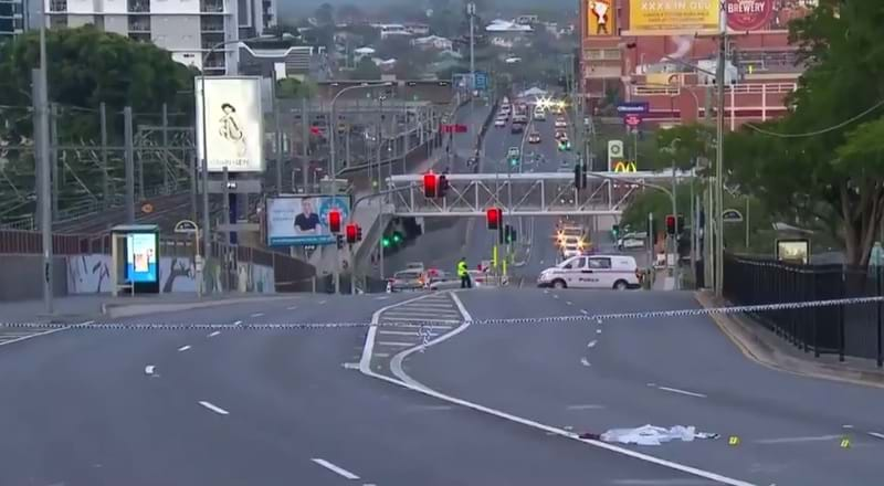 Man found stabbed on busy road in inner Brisbane