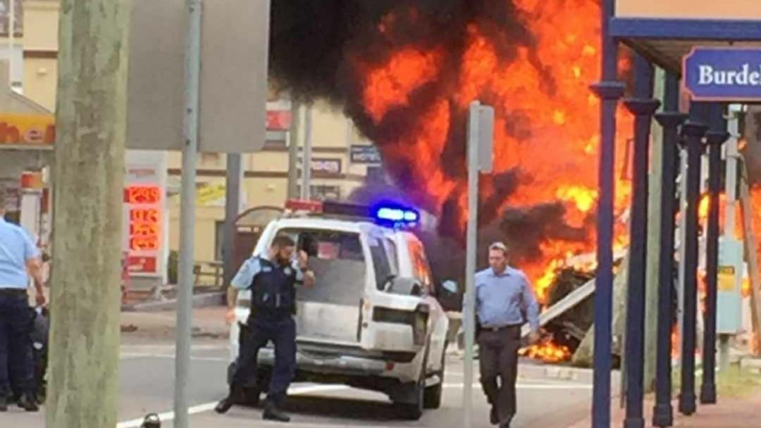 WATCH: Truck Bursts Into Flames After Crashing Into Building, Cars At Singleton