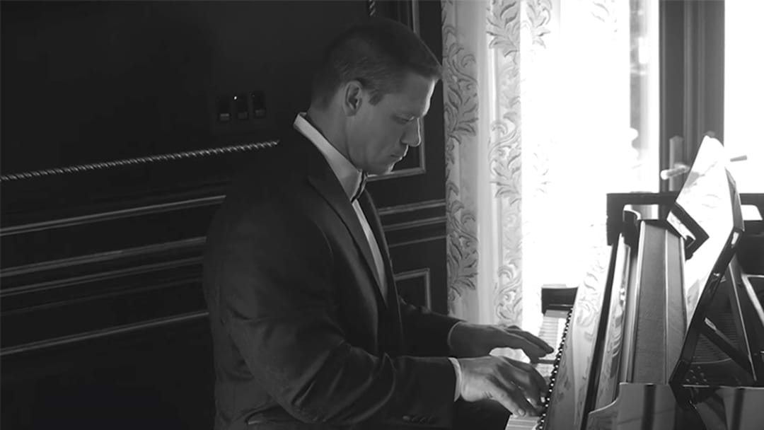 This Is Just John Cena Playing Piano In A Tuxedo