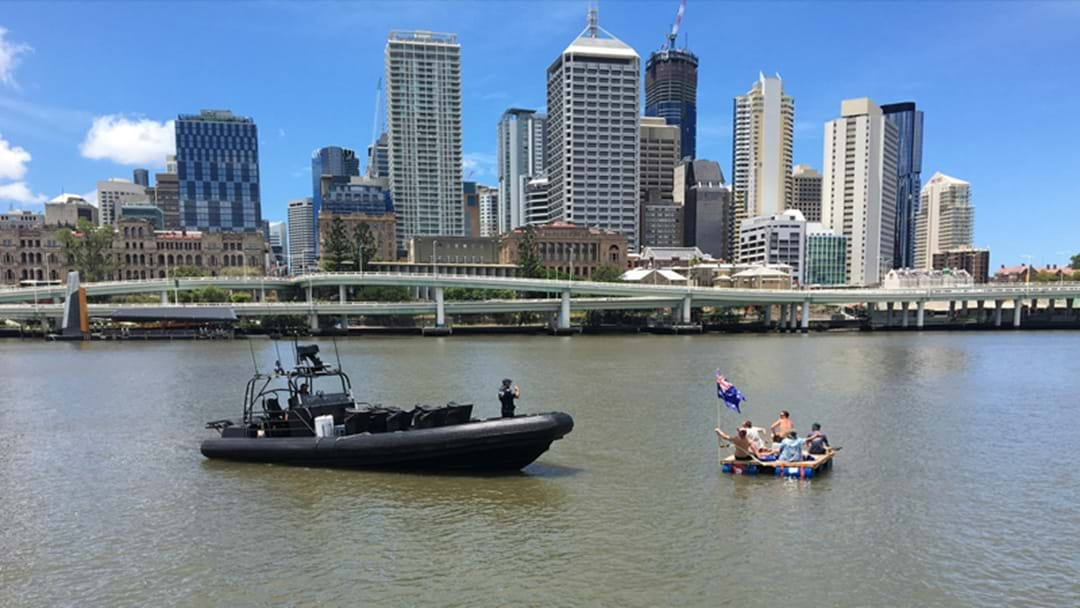 Blokes Build Themselves A Raft And Float Down The Brisbane River