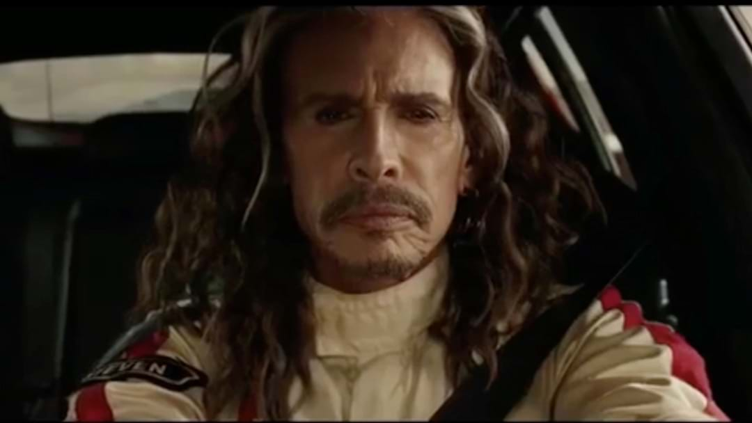 WATCH: Aerosmith's Steven Tyler Race F1 Champion In Car Commercial
