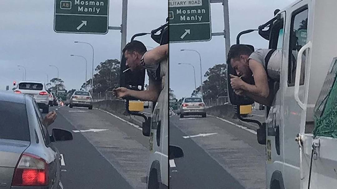 Local Aussie Legend Helps A Bloke Out With A Light On The Freeway