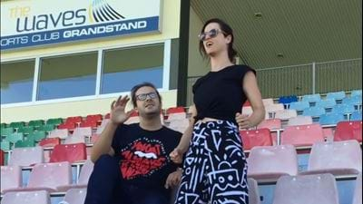 Nik teaches Jac how to behave in a footy crowd