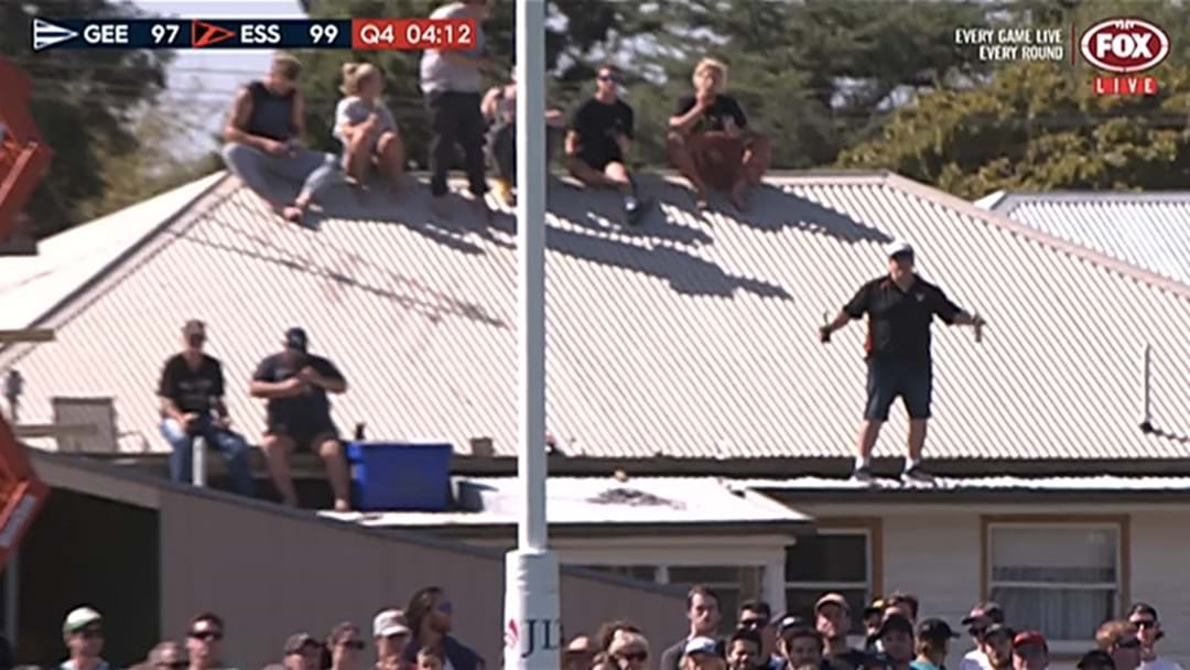 People Were Watching The JLT Game In Colac From A Roof Opposite The Ground