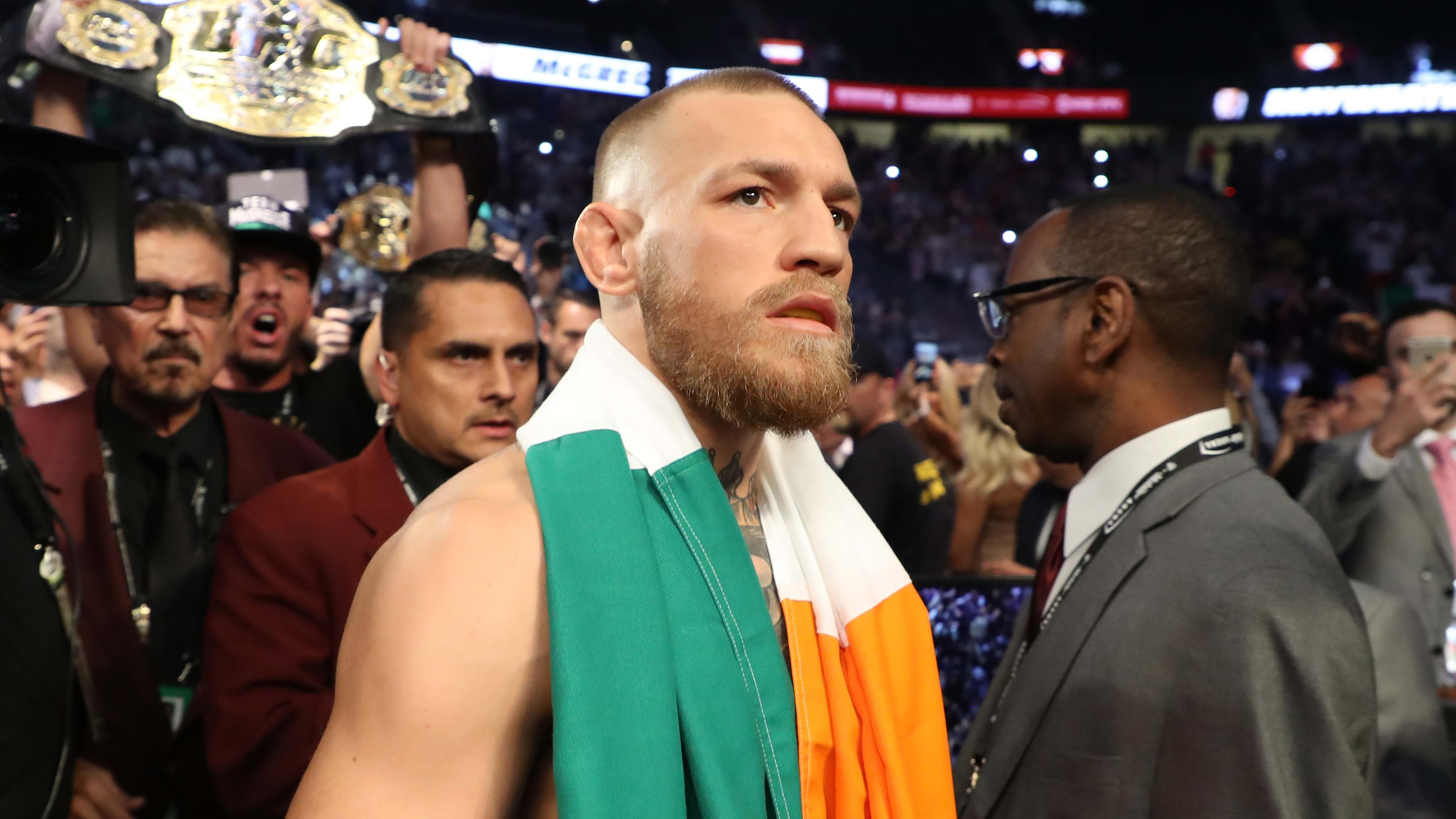 A handcuffed Conor McGregor expresses no remorse for UFC rampage