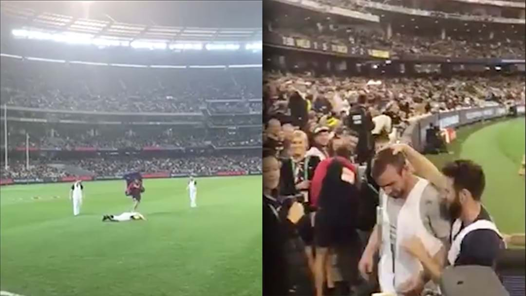 WATCH | Footy Fan Completely Stacks It During Quarter Time Marking Contest