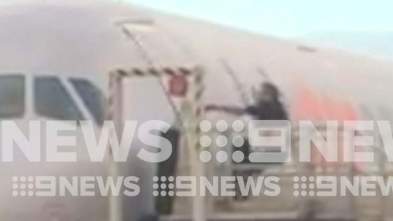 Man attacks Jetstar plane after storming the tarmac