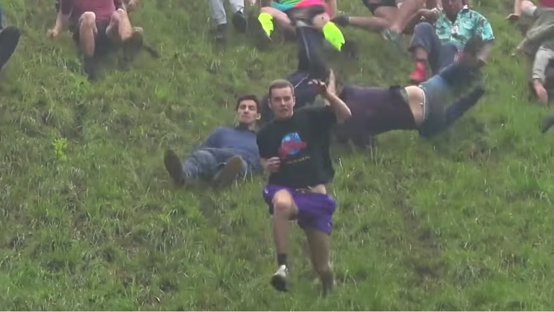 Please Enjoy This Video Of People Absolutely Stacking It At This Year's Cheese Rolling Championships