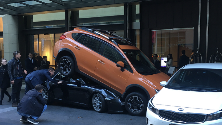 Freakish hotel parking accident leaves Porsche crushed under vehicle