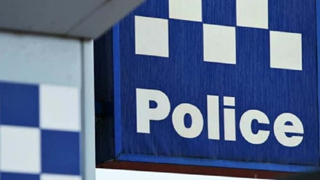 Woman Charged Over Real Estate Axe Attack