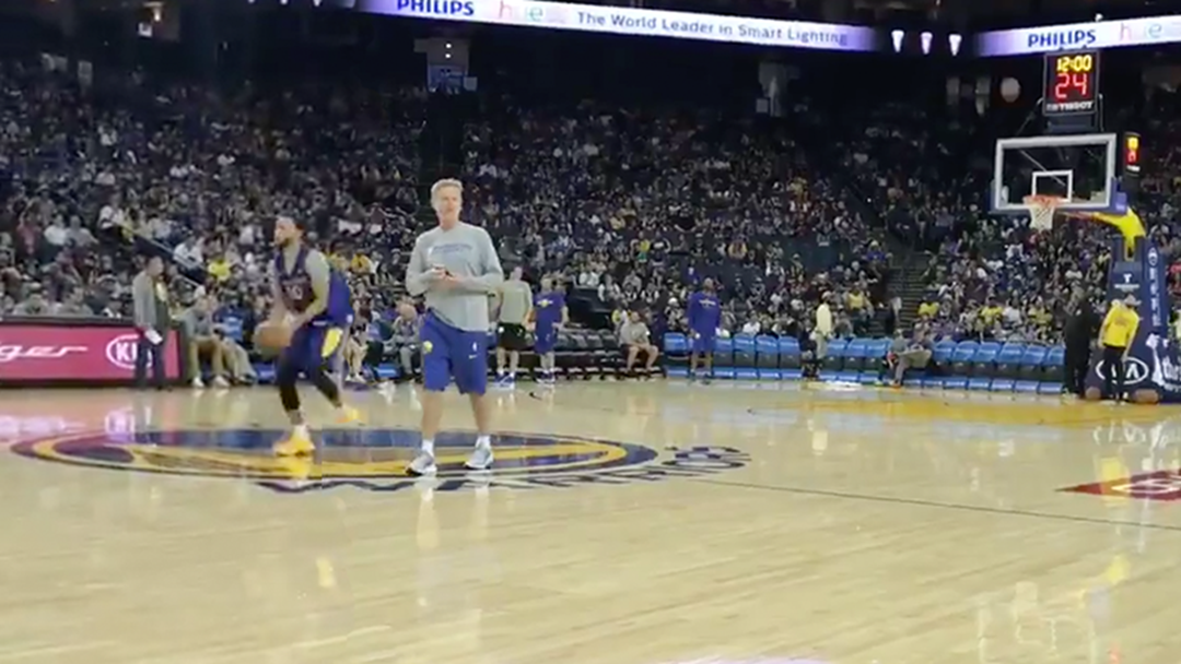 Watch Steph Curry Take The Piss By Draining A Behind-The-Back Shot From Half-Court