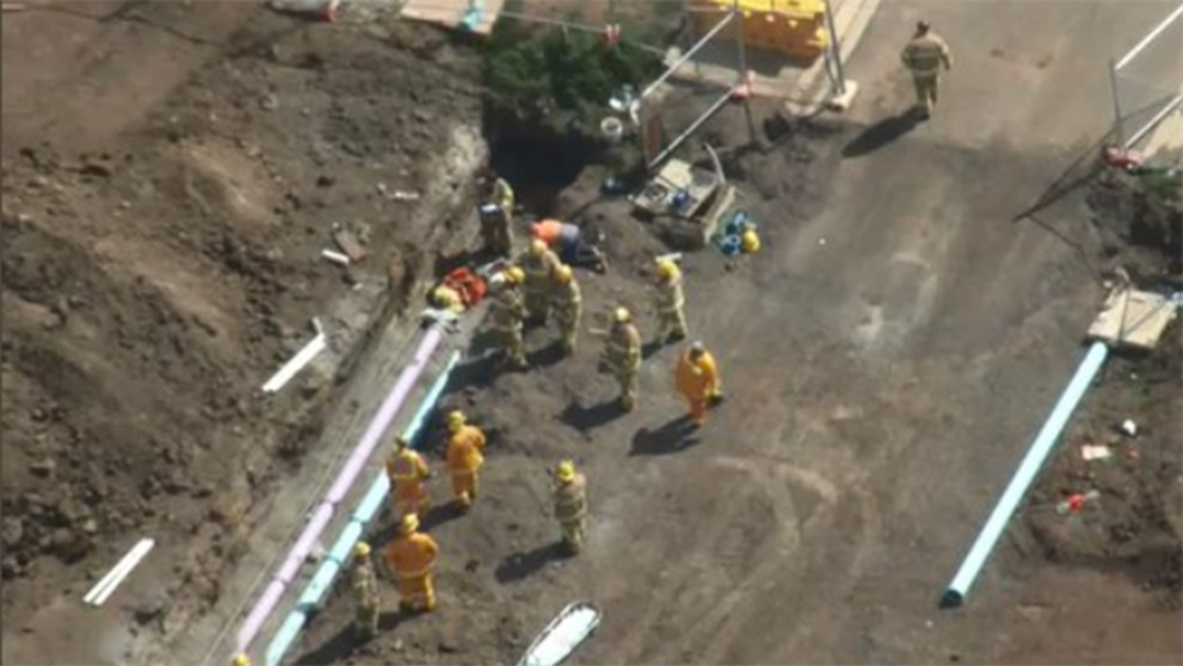 Emergency Services Attempting To Retrieve Man Stuck In Trench In Werribee