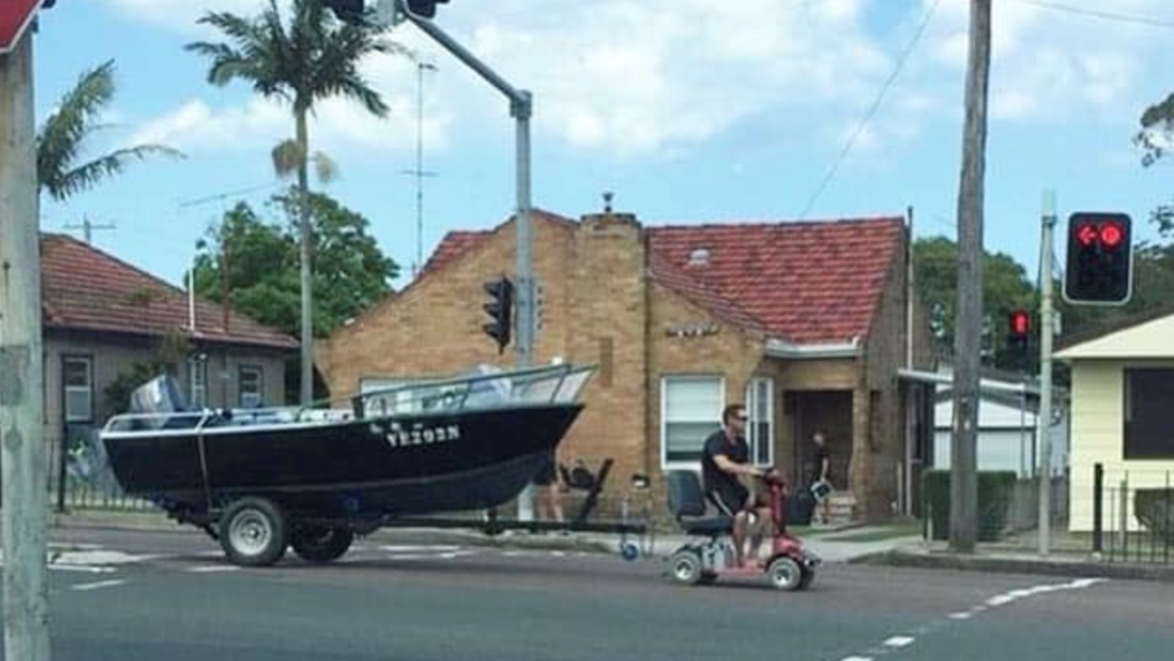 Bloke Charged For Towing His Boat Down The Highway With A Mobility Scooter