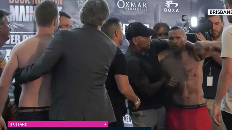 Chaos as Mundine attacks Horn at weigh