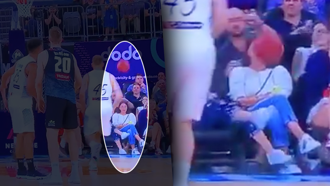 Oblivious Woman Front Row At The NBL Cops An Absolute Facial