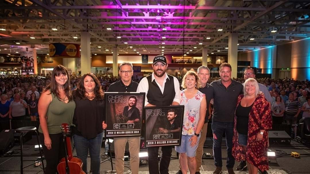 Chris Young Surprised with Plaques Commemorating 2 Billion Streams and 12 Million Singles Sold